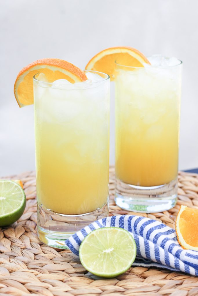 Orange Crush Cocktail | The perfect summer cocktail combines fresh squeezed orange juice, vodka, triple sec and seltzer for a refreshing drink that is perfect for a hot summer day. | HAPPY HOUR, COCKTAIL HOUR, SUMMER DRINKS, SPRITE, CRUSHED ICE, GRAND MARNIER | thebeautyblotter.com #orange #crush #cocktail #oceancity #summer #vodka