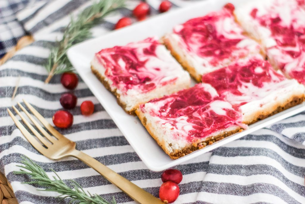 THE BEST HOLIDAY CRANBERRY CHEESECAKE BARS | Made with a buttery gingersnap crust, lemon scented cheesecake and zesty cranberry sauce this dessert is great for any holiday gathering or party. #holidaydesserts #dessert #cranberry #cranberries #gingersnaps