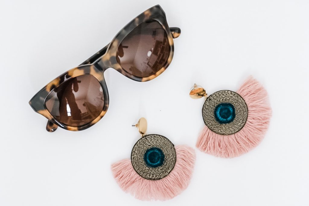 SPRING FASHION MUST HAVES | i am sharing all of my spring fashion must haves on the blog to freshen up your closet and get you ready for the warmer temps. This includes a cute pair of sunglasses, and a few tops to create many fresh spring outfits. I also share my shoe must haves to get you through the season. #sunglasses #springoutfits #traveloutfits #springcapsule #outfitideas